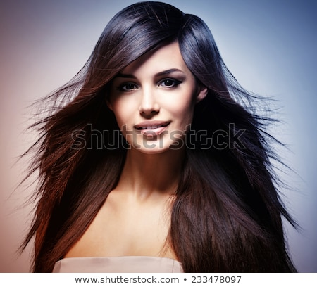 Fashion model with hair blowing in the wind in studio Stock photo © artfotodima