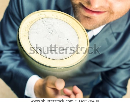 businessman hand tossing coin to flip on heads or tails stock photo © stevanovicigor