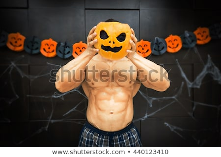 Halloween bodybuilder with pumpkin Stock photo © Firstonestock