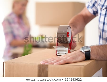 young woman with box in moving house concept stock photo © elnur