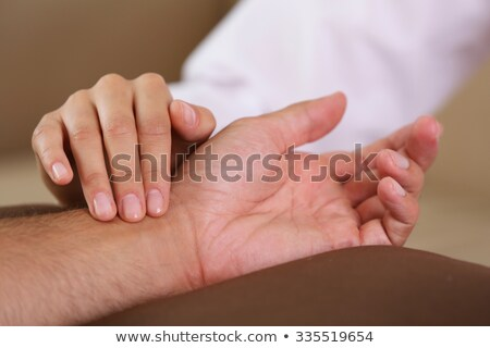 close up woman hands checking the heart rate pulse on the wrist Stock photo © Nobilior