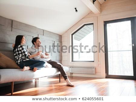 Szerelmespár pezsgő másfelé néz csinos férfi nő Stock fotó © deandrobot