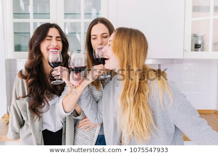 три · женщины · гостиной · шампанского · улыбаясь - Сток-фото © monkey_business
