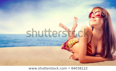 Portrait of a smiling pretty woman in swimsuit Stock photo © deandrobot