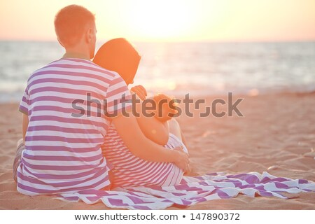 young mother with son resting on sea coast happy family togethe stock photo © iordani