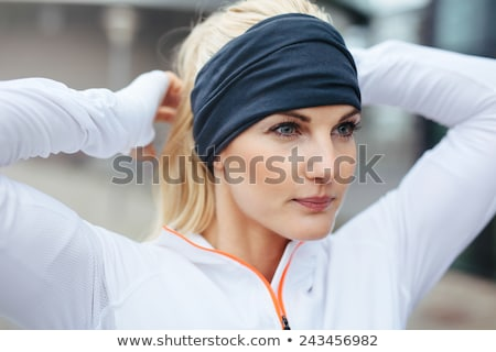Close-up of young female athlete tying  hair before a run Stock photo © chesterf