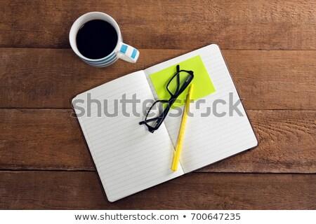 表示 ブラックコーヒー 主催者 眼鏡 ペン 付箋 ストックフォト © wavebreak_media