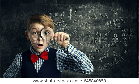Magnifying glass on chalkboard background Stock photo © Sonya_illustrations