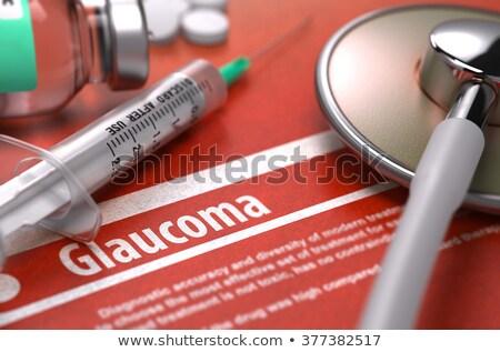 Glaucoma - Printed Diagnosis on Orange Background. Stock photo © tashatuvango