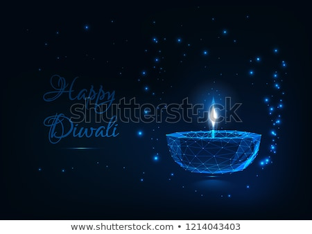 Stock photo: illustration of burning diya on blue background for happy diwali