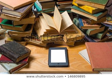 Nowoczesne ebook czytelnik starego papieru książek odizolowany Zdjęcia stock © digitalr