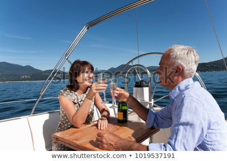 Couple making a toast on sailboat Stock photo © IS2
