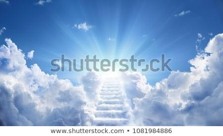 Brillante luz del sol celestial nubes abajo cielo Foto stock © palangsi