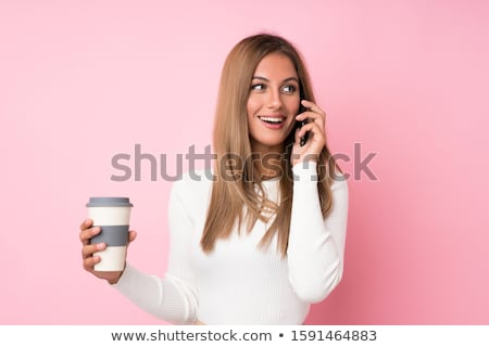 young blond with hot beverage stock photo © lithian