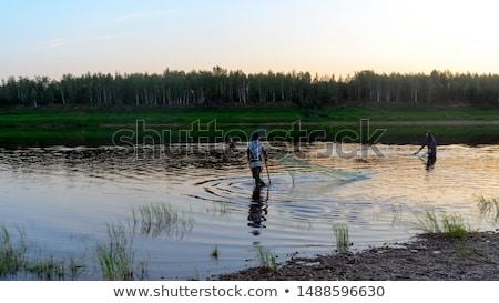dos · ninas · tomados · de · las · manos · caminando · arroyo · familia - foto stock © is2
