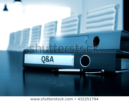 question and answer on file folder toned image stock photo © tashatuvango