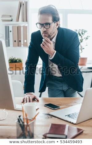 Biznesmen strony podbródek portret zamyślony okulary Zdjęcia stock © LightFieldStudios
