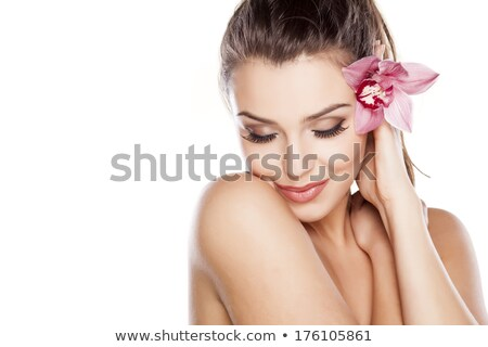 young woman with orchid flower isolated on white stock photo © elnur