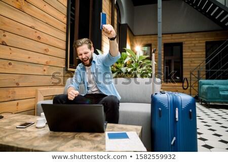 Jóvenes viaje hombre pasaporte billete oficina Foto stock © studioworkstock