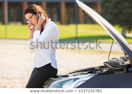 Woman calls to a service standing by a white car. Stock photo © Nobilior