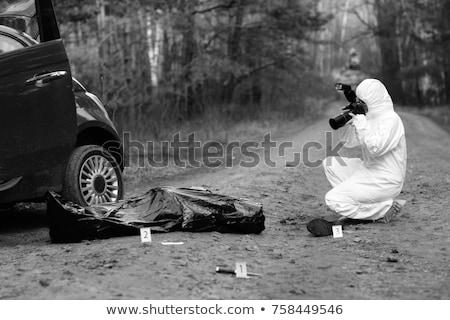 Stockfoto: Criminalist Photographing Dead Body At Crime Scene
