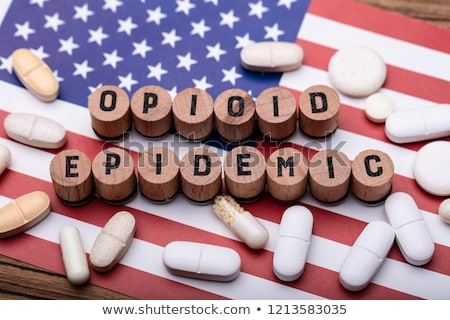 Opioid Epidemic Text With Prescription Pills Over American Flag Stock photo © AndreyPopov