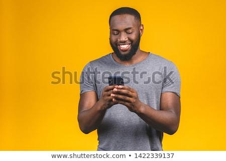 肖像 アフリカ系アメリカ人 男 笑みを浮かべて スマートフォン ストックフォト © deandrobot