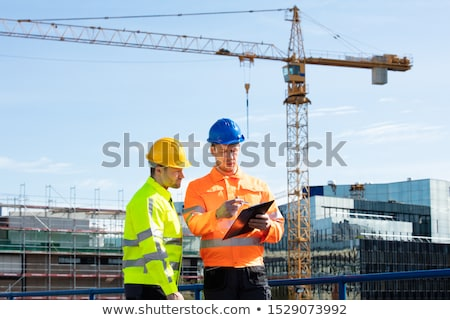 Architect Engineer And Manual Worker Meeting In Construction Site Stock photo © diego_cervo