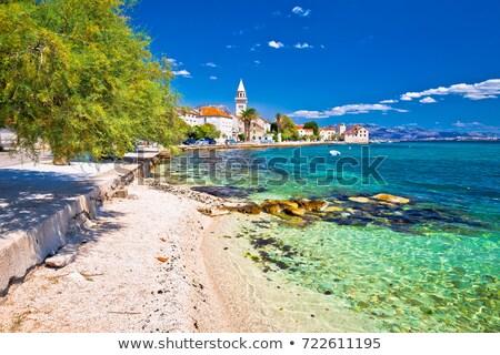 Photo stock: Turquoise · bord · de · l'eau · vue · région · plage · ciel