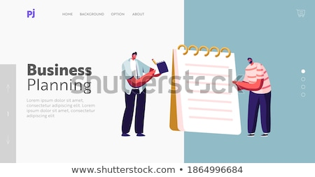 Stock photo: Person Writing On Chequered Spiral Notepad