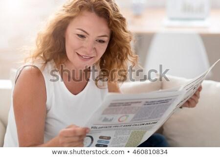senior woman reading newspaper at home Stock photo © dolgachov