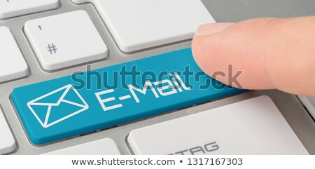 a keyboard with a blue labeled button   e mail stock photo © zerbor