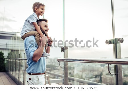 Smiling father spending time with his little son at the park Stock photo © deandrobot