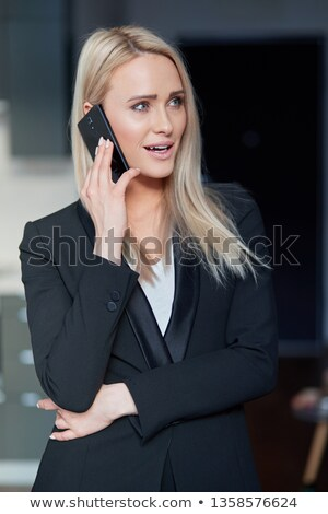 Smiling blonde middle age woman, managing director having smartphone conversation Stock photo © dash