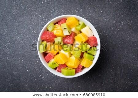 Agrios bolos frutas piedra mesa Foto stock © dolgachov