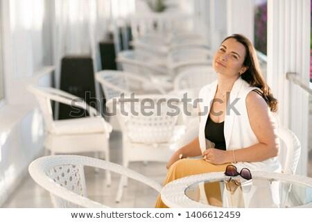 Elhízott üzletasszony ül kávézó tart kávé Stock fotó © ElenaBatkova