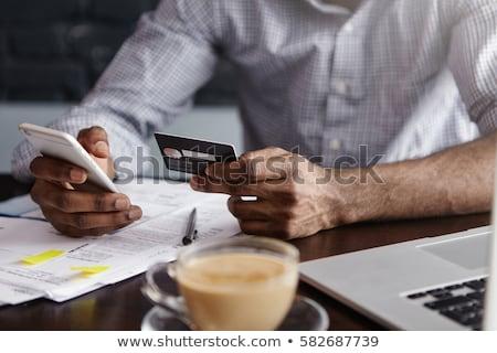 adam · dizüstü · bilgisayar · kredi · kartı · teknoloji · alışveriş - stok fotoğraf © deandrobot