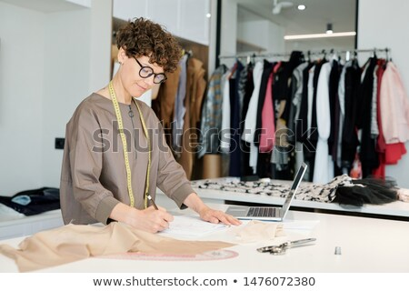 Contemporary young casualwear designer drawing sketch of garment Stock photo © pressmaster
