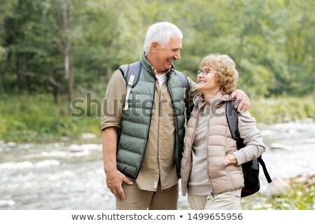 два зрелый туристов глядя один Сток-фото © pressmaster