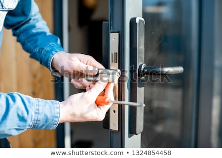 mosolyog · ezermester · ajtó · férfi · boldog · ipar - stock fotó © andreypopov