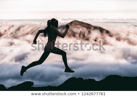 Fut emberek sportolók sziluett nyom hegy Stock fotó © Maridav