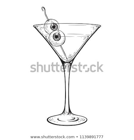 Glass with Halloween cocktail with human eyeballs. Stock photo © artjazz