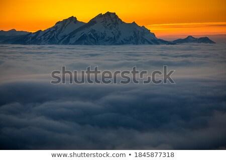 декораций высокий гор тумана вечер свет Сток-фото © lightpoet