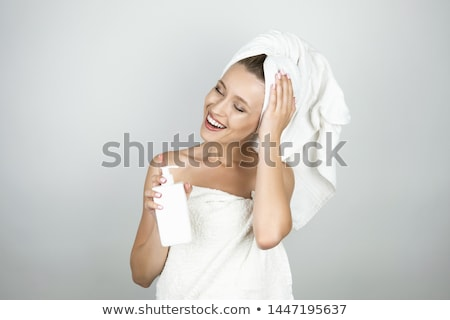 Woman with body lotion, isolated on white background. stock photo © Nobilior