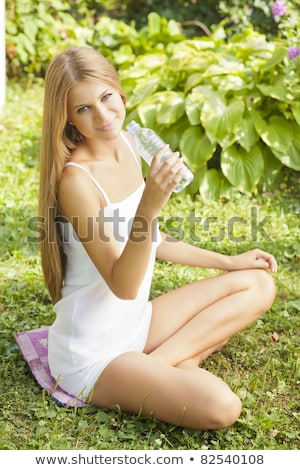 Beautiful Woman Dring Water In Nature stock photo © adamr