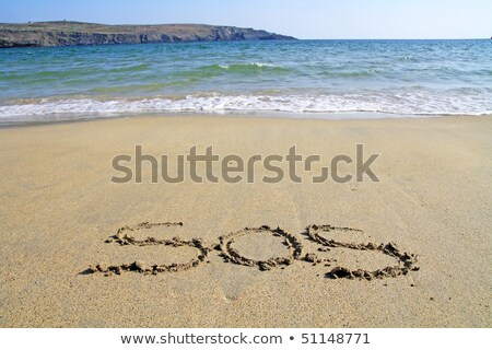 Strand sos golven hot wolken Stockfoto © morrbyte