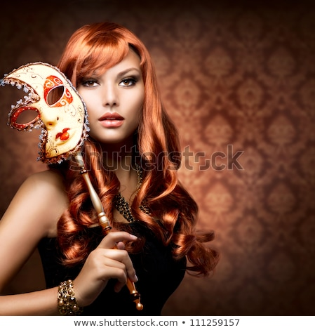 girl in the red masquerade mask stock photo © RuslanOmega