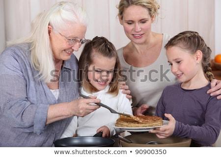 Três gerações comida sorrir mulheres Foto stock © photography33