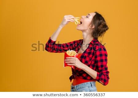 Kobieta jedzenie frytki żywności usta obiedzie Zdjęcia stock © photography33