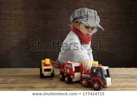 Girl with a toy fire engine Stock photo © photography33